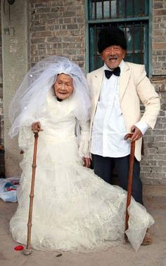 Wu Conghan is 101 years old, his wife is 103. They are married since 88 years and this is their first wedding photo. :)  So adorable!!!