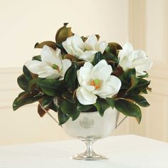 REGAL MAGNOLIA CENTERPIECE I have these started in another vase but I think I like this better.  Idk