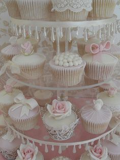 Very feminine vintage chic cupcakes.  I really wish I could see how real lace is attached to the one at the top of the display.  Oh, and aren't the drop icicle beads on the cake stand a lovely touch!