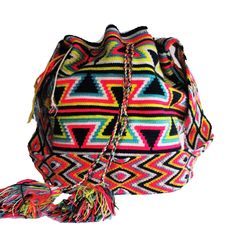 Buy Wayuu Bags Online-Colombian Bags Retailers and Wholesalers-Suscribe and Get 3 FREE Wayuu Bracelets with your first purchase! Tribal Patterns, Crochet Patterns, Light Pink Color, Dark Brown Color, Tapestry Crochet, Turquoise Color, Crochet Fashion, Electric Blue, Online Bags