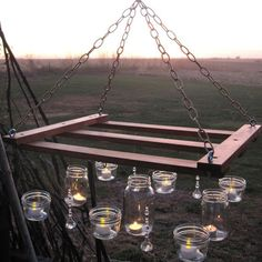 More mason jar fun. Pot rack style outdoor lighting. Cheap and adorable project! So many ways to customize this!