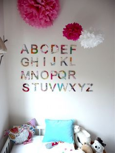 bright, magenta, pink, white walls, pops of color, alphabet on walls, happy nursery ideas
