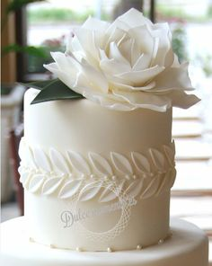 Elegance and simplicity crowned with an oversized gum paste rose by gateaux-inc. wedding cakes cakes elegant cakes rustic cakes simple cakes unique cakes with flowers Beautiful Wedding Cakes, Gorgeous Cakes, Pretty Cakes, Unusual Wedding Cakes, Amazing Cakes, Fondant Cakes, Cupcake Cakes, White Fondant Cake, Fondant Wedding Cakes