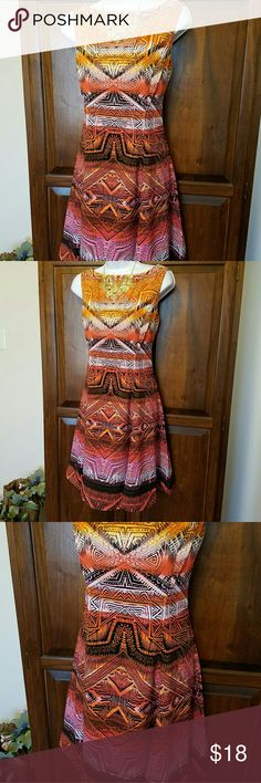 Pink/Orange print dress Cute pink/orange dress.  Never worn. Smoke free home. Dress Barn Dresses