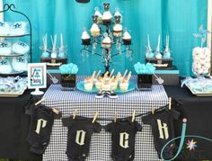 This is the table setting we used for my little sisters Rock a Bye Baby Shower. The backdrop fabric, and the tableclothes are easily found almost anywhere!  Check out my **Rock a Bye Baby Board** for a Printable version of the 'Rock a Bye' Onesie Banner! Rock a Bye baby shower. #baby #shower