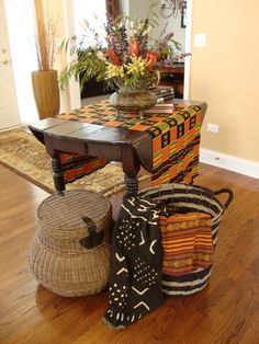 I love the use of all the textural elements; kente cloth, mud cloth, baskets, etc.