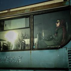 @Regrann from @everyday.tehran -  A woman ride a bus to Tajrish one of the biggest shopping areas in north of Tehran which interests many people for their shopping for the persian new year.  Photo by: @ttahmine #everydaytehran  زني با اتوبوس به سمت تجريش مي رود يكي از بزرگترين مراكزي كه مردم را براي خريد عيد جلب مي كند. عكس از تهمينه گدازگر #Regrann