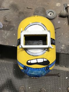 Minion welding hood i finished at work today for a friend (more pics in comments) Welding Hood, Welding Equipment, Work Today, Airbrush, Wood Working, Minions, Hoods, Diy And Crafts, Garage