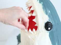 Learn how to make a shark cake (with fish candies inside!) with this step-by-step tutorial on the Food Network. Shark Cupcakes, Shark Cake, Shark Birthday Cakes, 8th Birthday, Birthday Ideas, Beach Dessert, Fish Candy, Cute Shark, Cute Cakes