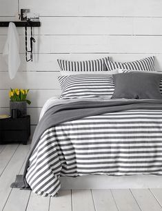 The new Contemporay Coastal bedroom trend is our favourite this season. Mix monochrome stripes with white washed wood to achieve this nautical bedroom for Spring.