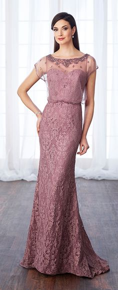 Allover lace and tulle fit and flare gown with scattered hand-beading features beaded illusion cap sleeves, heavily beaded bateau neckline, beaded illusion blouson over a sweetheart bodice with beaded natural waist, beaded illusion blouson back with keyhole, sweep train.