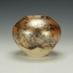 Raku fired pottery covered in several layers of Terra Sigillata and hand polished. This piece is unglazed.