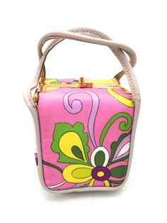 Adorable cube shaped mini- purse , attributed to Pucci by the previous owner and I agree, it is a Pucci Print. The bag is soft sided but sturdy and made of printed silk in bright colors with purples d