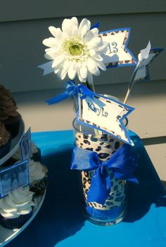 Royal blue and cheetah print graduation party table centerpieces...pennant with each of the three girls' names