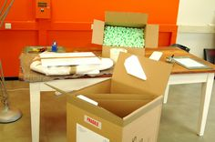 With the mirror sealed in protective foam wrapping and solid foam side buffers, the Quantun box is prepared.