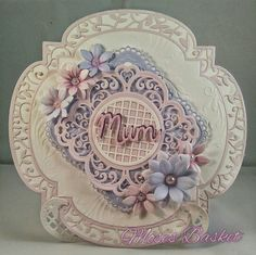 Mothers day card. Base made with Tonic twisted veranda dies. Also used Sue Wilson dies. Flowers made with Sara Davies Signature dies.