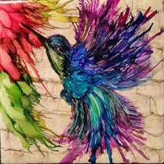 Humming bird in alcohol ink on tile with touch up and no frame. More
