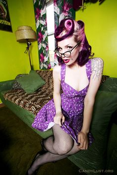 Cute pink victory rolls, cat eye glasses and cute dress