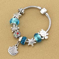 Item Type: Bracelets Gender: Women Material: Crystal Chain Type: Snake Chain Length: 17-21cm Shape\pattern: Animal Bracelets Type: Charm Bracelets Color: Blue Shape: Shell/Sea Turtle/Starfish Occasion