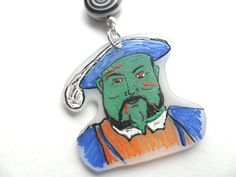 Hahaha! It's a zombie Henry VIII pendant.  This would be fun to make.