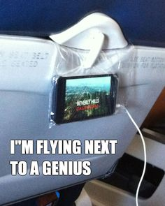 Genius! Best way to watch a movie on your phone on the plane