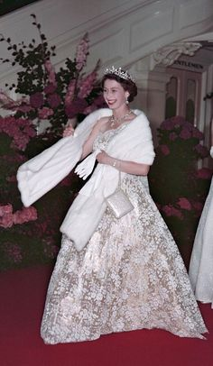 1954. Queen Elizabeth II leave a banquet during their Commonwealth visit to Australia, 1954.