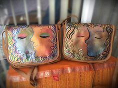 These hand-painted leather bags belong to the Painted Faces line by Sue Sweeney. H collectible bag is one-of-a-kind signed original art. www.facebook.com/SueSweeneyArt  www.Etsy.com/Shop/SueSweeneyArt SueSweeneyArt @SusanSw85579316