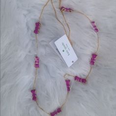 """Kate spade take a bow purple necklace 32"""" New. Tag attached, but no pouch. It is gold with purple enamel bows. kate spade Jewelry Necklaces"""
