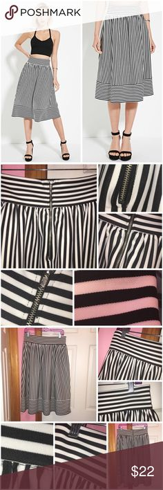"Striped Pleated Skirt Never worn besides modeling in the photos. Has been washed. Scuba knit. All over striped pattern. Contrast waist. Exposed back zipper. 96% polyester and 4% spandex. (Shirt in photos of me modeling is not for sale.) Approx 27.5"" in length and approx 30"" waist. ❌NO TRADES❌ Forever 21 Skirts Midi"