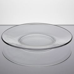 """Anchor Hocking Oneida 842U 8"""" glass salad/buffet plate  - perfect for your appetizers, side dishes, salads, and desserts. Its elegant design is versatile enough for restaurants, hotels, or catered events. This Anchor Hocking Oneida 842U glass plate features a sleek, wide-rim and modern glass construction. This plate measures 8"""" in diameter."""