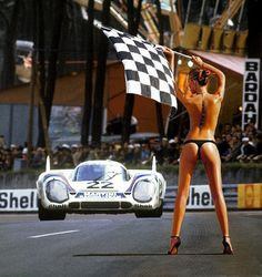 https://flic.kr/p/jMsvih | Porsches at Le Mans - 1969 to 1973 | Sports Car Digest has done a very nice story with photos about Porsche at Le Mans during the period 1969 to 1973. In the photo above is the 1971 Le Mans winning Porsche 917 KH of Gijs van Lennep and Helmut Marko. You can assume the young lady was not on the track waving the checkered flag at the finish. I put her in the picture to see if you were paying attention. You can see the full story by going to: www.sportscardigest....