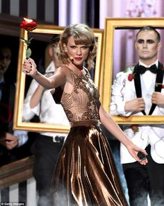 Girl on fire: She didn't mess around when it came to the props even holding a flaming rose during the performance