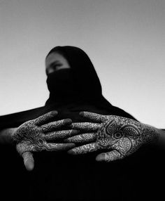| Young Moroccan woman with henna design on her hands. Southern Moroccan desert  |