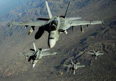 """F-18 """"Hornets"""" in flight."""