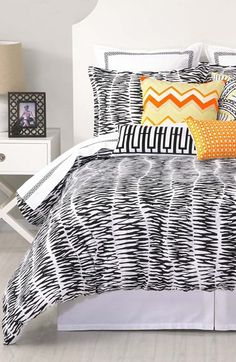 Fun bedding! Love the pop of orange against the zebra print.