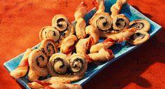 Palmiers aux olives et flûtes au jambonVoir la recette des Palmiers aux olives et flûtes au jambon >>