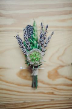 lavender boutonniere // photo by The Nichols // View more: http://ruffledblog.com/surprise-texas-wedding/