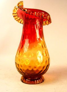 One amberina glass vase with ruffled lip
