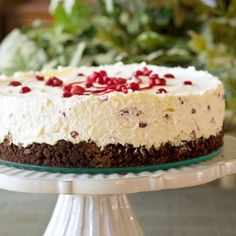 This no-bake cheesecake from ItsYummi.com has a chocolate cookie crust, a whipped cream cheese base, and a sweet crunchy pomegranate topping.