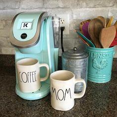 "Tiffany blue Keurig and cute coffee mugs in front of a ""brick"" backsplash made using NuWallpaper"