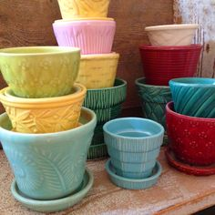 Vintage McCoy Pots are so decorative and versatile.  Can you imagine starting with this many?! ~ Mary Walds Place - I Love Collecting: FLOWER POTS!