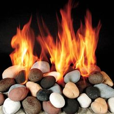 Log Alternatives: Stone    Calico-colored ceramic rocks have a rustic feel that would fit right in a mountain cabin.     32 pieces for a 24-inch fireplace, $259; Rasmussen Iron Works, Inc.