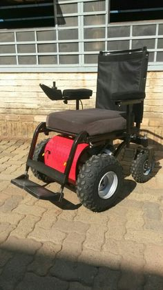 Red Dassie 200 M Power Wheelchair with cool All Terrain Castors