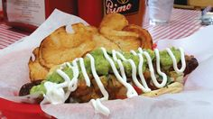 Sonoran Hot Dog – bacon wrapped, 8-inch Mad Mike's hot dog, covered in refried beans, homemade guacamole, fresh pico de gallo and drizzled with sour cream. Ashley Ludwig photo.