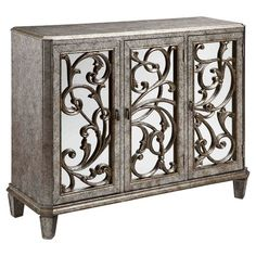 Wood cabinet with fretwork detail.    Product: CabinetConstruction Material: Mirrored glass and woodC...