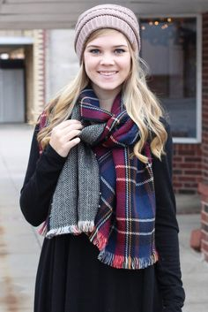 Soft and cozy reversible wrap scarf with frayed edges. One side is a navy/red mix of plaid and the other is black/white herringbone. Wear it with both showing or just one side.