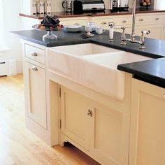 Farmhouse sink and soapstone countertop