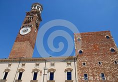 Photo made in Verona which is located in Veneto (Italy). Fotoscattata in Piazza delle Erbe, the center of social, economic and religious life of Verona, the thirteenth-century palace of reason (aka Del City), dominated by the Lamberti tower. The tower was erected in 1172 by the family following the Romanesque style typical of the era and still visible at the bottom, made of brick alternating tuff.
