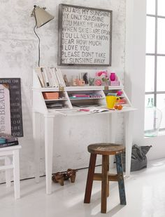 I like the art work above the desk.  This would be super easy with stamps, an Ikea frame and your favourite lyrics.  A must do!