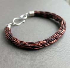 Unique leather chain braid.  Will be fun tracking this braid method down - kumihimo?    ** UPDATE : Aha!  Similar fingerloop & kumihimo braiding patterns found at this link ~ http://www.unikatissima.de/e/?p=2571#     #handmade #jewelry